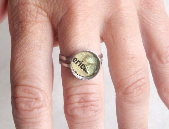 A ring made from a credit card and broken windshield glass